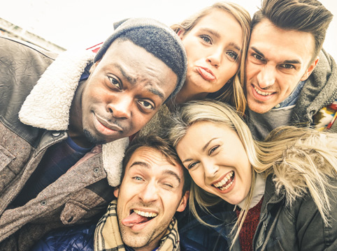 group of people making silly faces for a selfie