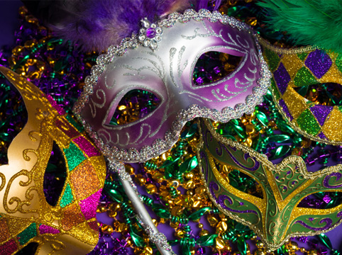 Mardi Gras masks with colorful beads and feathers