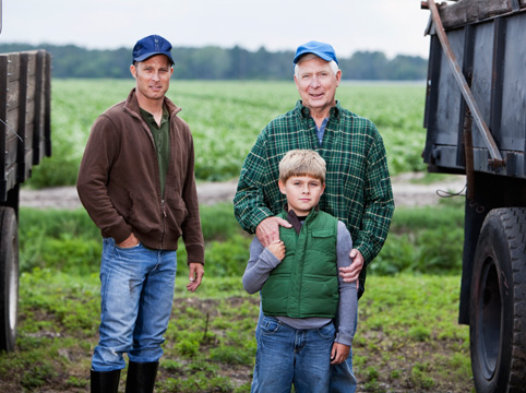three generations of farmers in their field